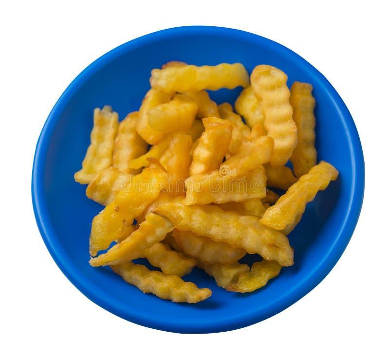 batatas fritas em uma placa isolada no fundo branco batatas fritas em uma opinião superior da placa Comida lixo fotografia de stock royalty free