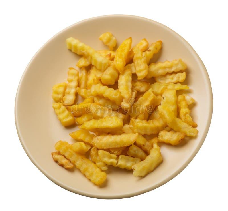 batatas fritas em uma placa isolada no fundo branco batatas fritas em uma opinião superior da placa Comida lixo fotografia de stock