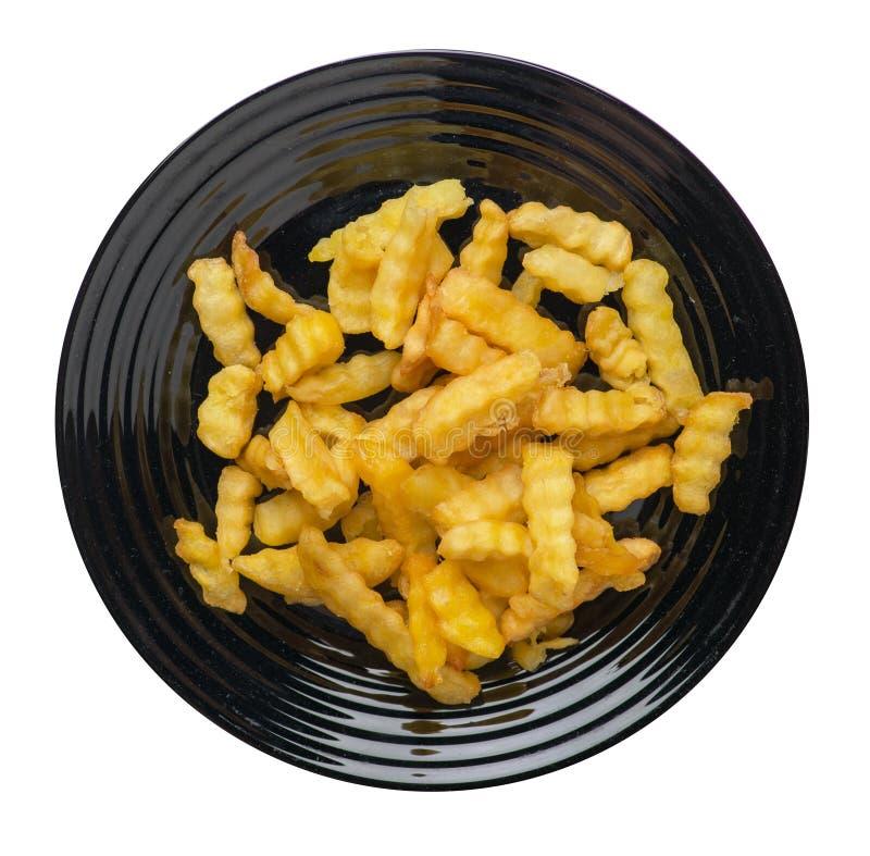 batatas fritas em uma placa isolada no fundo branco batatas fritas em uma opinião superior da placa Comida lixo imagens de stock