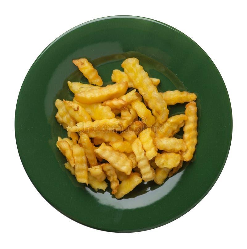 batatas fritas em uma placa isolada no fundo branco batatas fritas em uma opinião superior da placa Comida lixo foto de stock royalty free