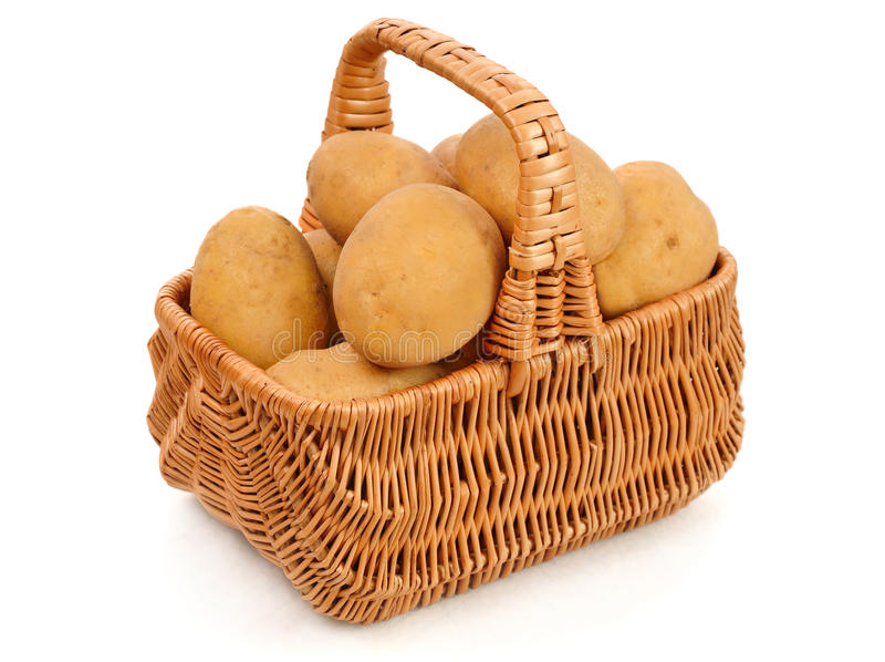 Batatas na cesta foto de stock royalty free