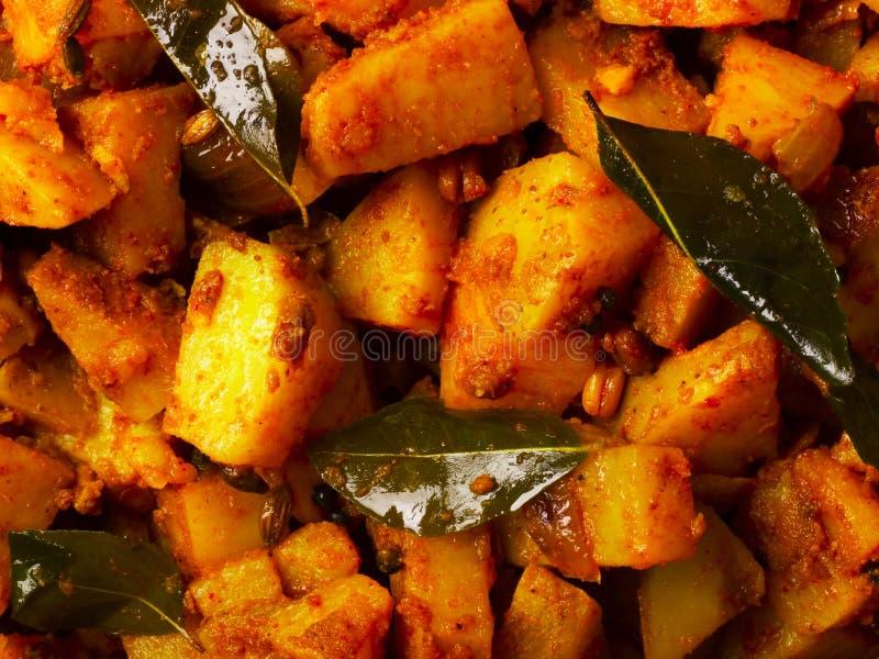 Batatas picantes do caril foto de stock