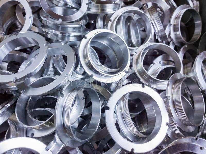 A batch of machined shiny aluminium parts with selective focus stock photos