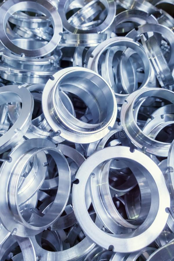 A batch of machined shiny metal parts with selective focus royalty free stock photos