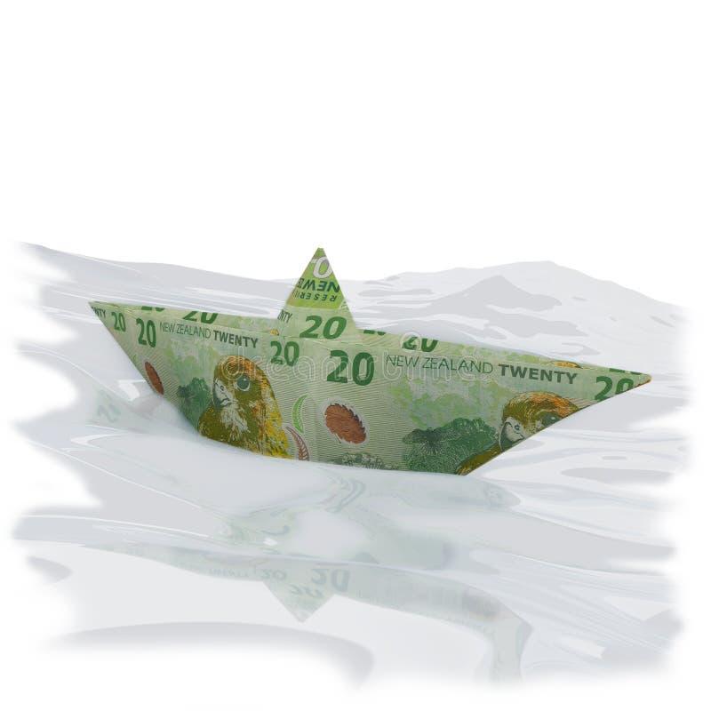 Bateau de papier avec vingt billets d'un dollar de Nouvelle Zélande photos libres de droits