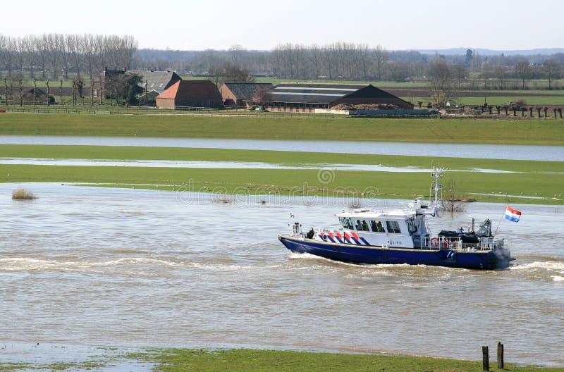 Bateau de police hollandais sur le fleuve image libre de droits