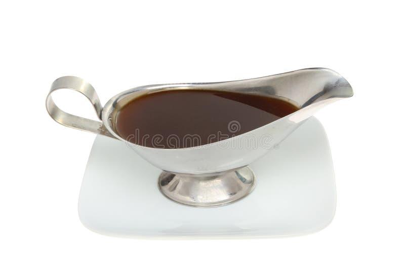 Bateau de sauce au jus d'un plat image libre de droits