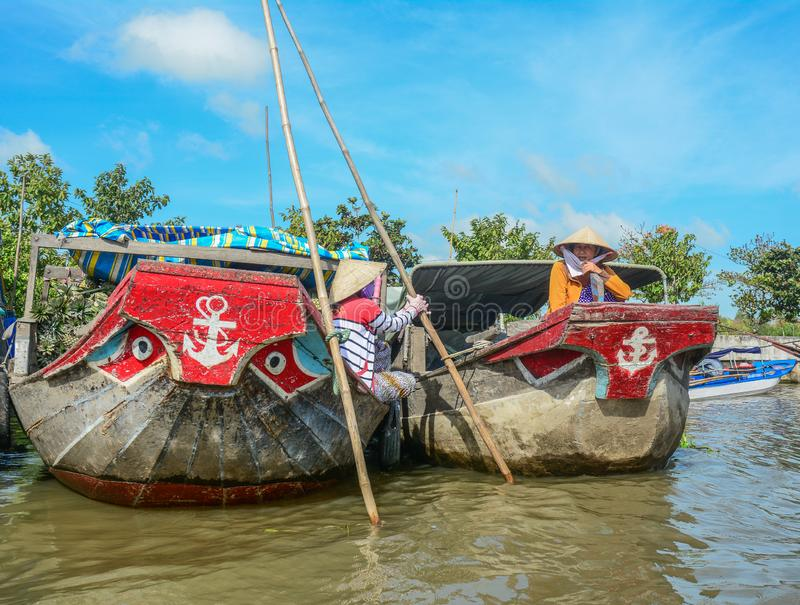 Bateaux en bois sur le Mekong photo stock