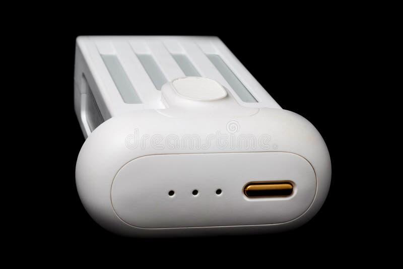 Batería blanca para el primer del abejón en un fondo negro Aislado fotos de archivo libres de regalías