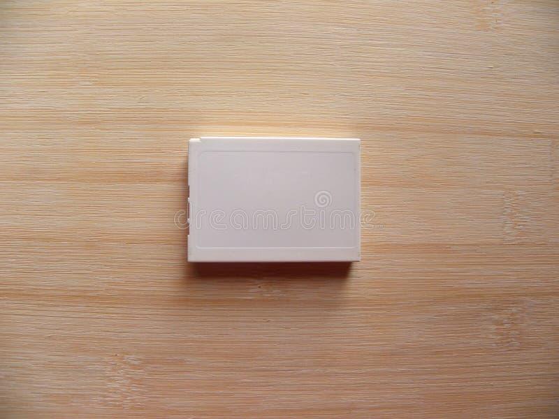 Bateria recarregável da câmara digital branca imagem de stock