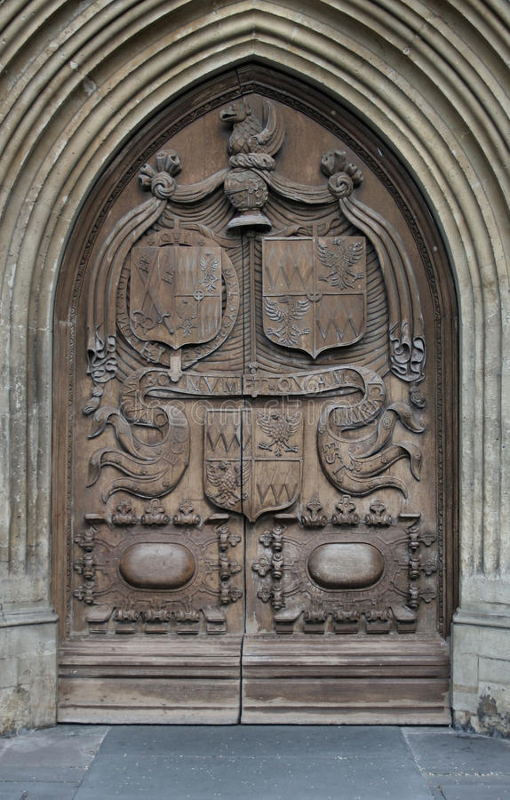 Bath Abbey Main Entrance. The main entrance door to Bath Abbey showing ornate carvings and Christian religious symbolism royalty free stock photos
