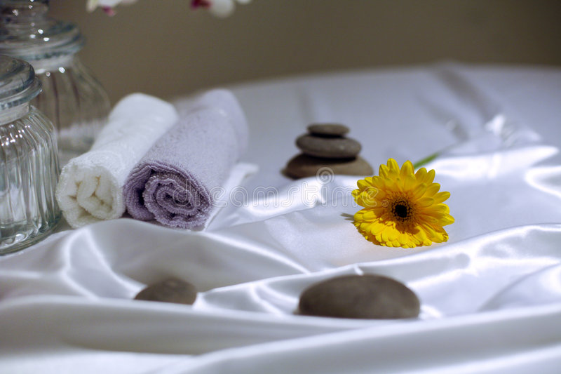 Bath accessories. Stones, towels and flower in the bath room stock images