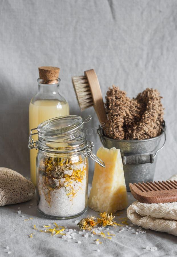 Bath accessories - homemade sea salt with calendula, natural shampoo, brush, washcloth, pumice, homemade oat soap. Health, beauty royalty free stock photo