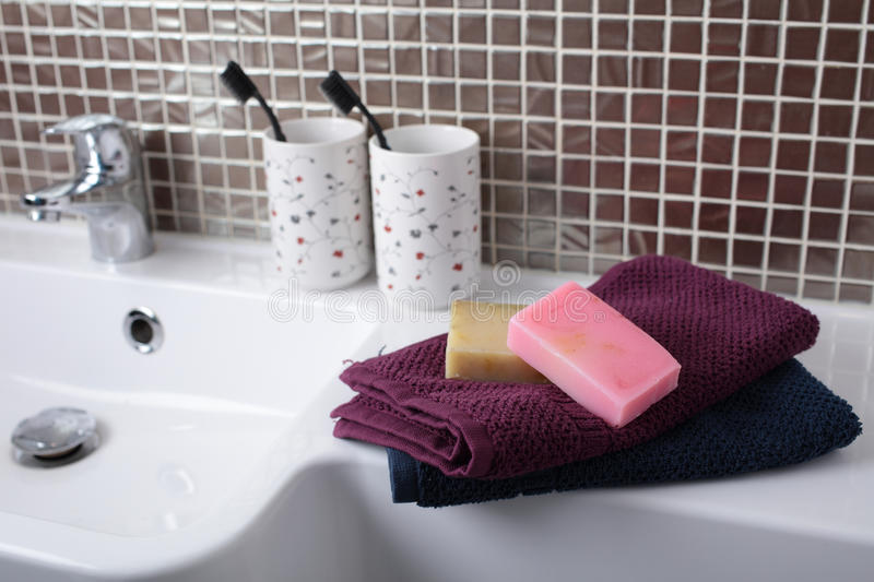 Bath accessories. Soap, towels, toothbrushes and other accessories in a bathroom royalty free stock images