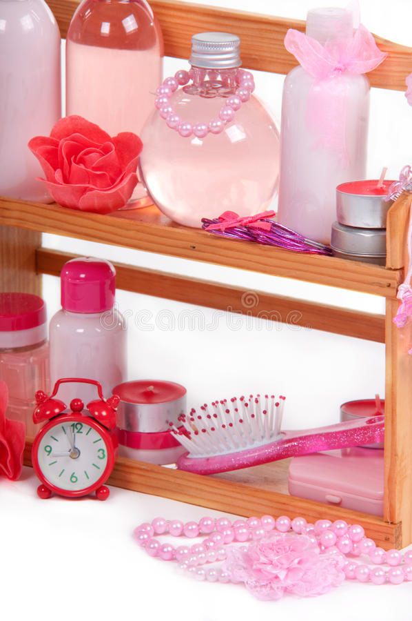 Bath Accessories On A Wooden Shelf And Alarm Clock Royalty Free Stock Images