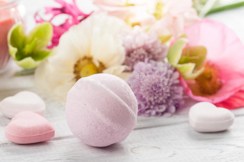 Bath bombs on old wooden background stock photo