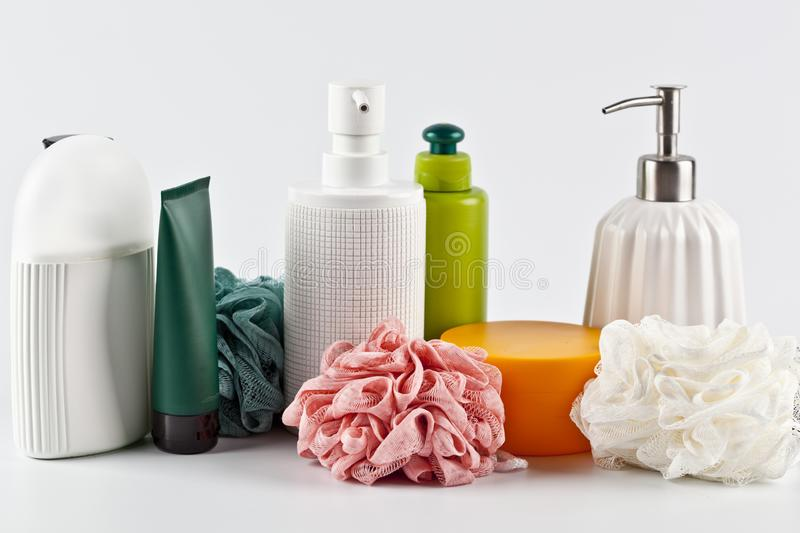 Bath cosmetic products set and sponges on light background stock images