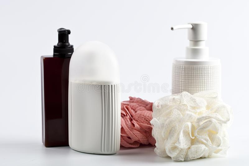 Bath cosmetic products and sponges on light background stock photography