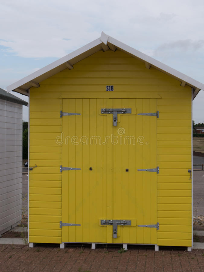 Bath cottage. Small british cottage on the seaside in yellow for storing accessoires and drinking tea stock photo