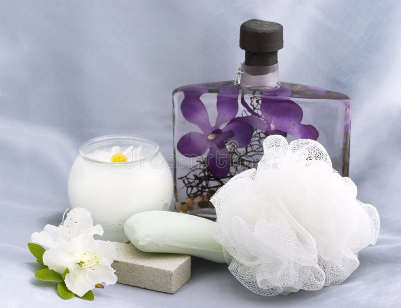 Bath essentials with chamomile candle royalty free stock photos