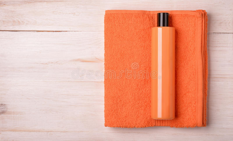Bath gel and towel. On wood background royalty free stock images