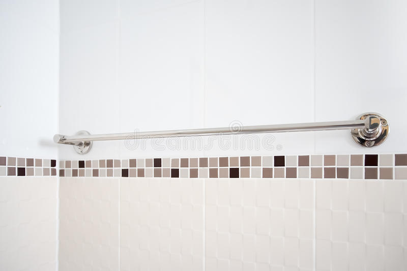 Into the bath room, towel rack. And mosaic wall royalty free stock photo