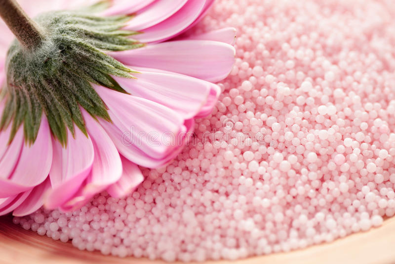 Bath salt with gerbera stock photo