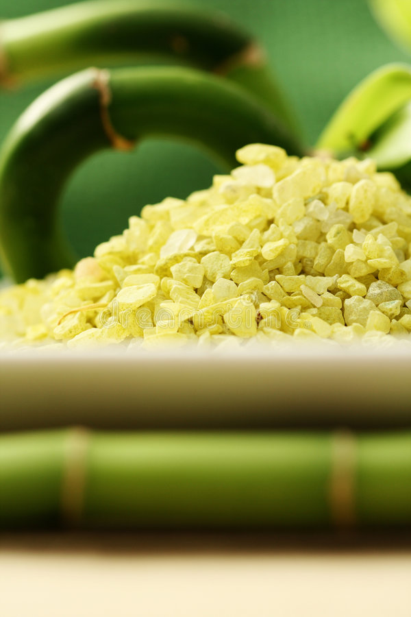 Bath salt with green bamboo. Body care royalty free stock photo