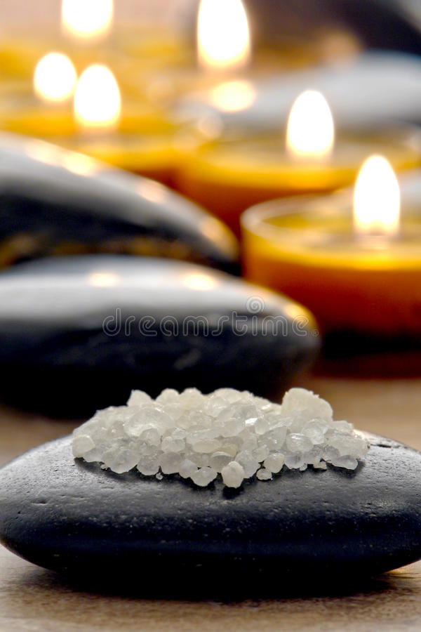 Bath Salts on Polished Stone with Candles in a Spa royalty free stock photography