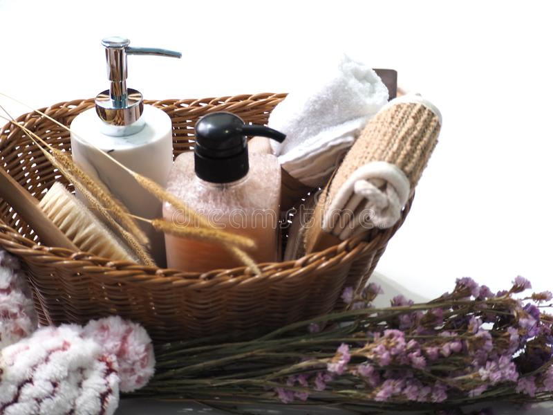 Bath set in the basket with flower decoration on white background royalty free stock photos