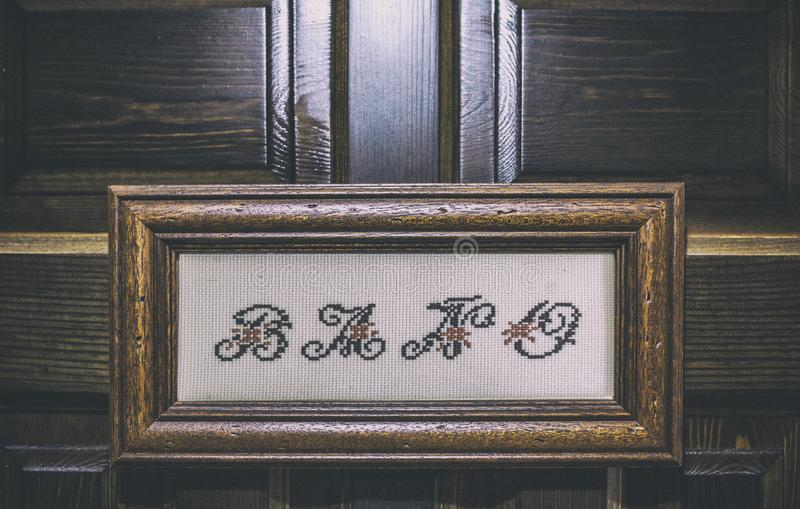 Bath signboard made with embroidery craft. Retro style decoration for bath royalty free stock photo