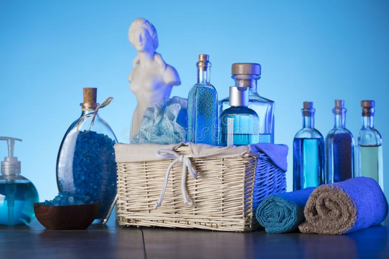 Bath and spa concept. Difeerent cosmetics on stone table and blue background stock photo