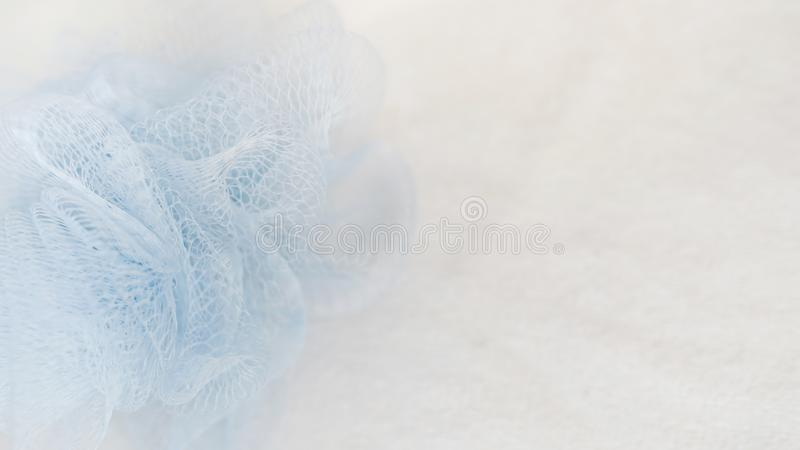 Bath sponge on white background with copy space. sponge on towel , spa concept place for text.  royalty free stock images