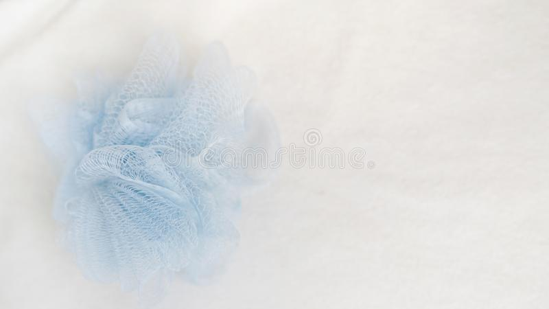 Bath sponge on white background with copy space. sponge on towel , spa concept place for text.  stock photo