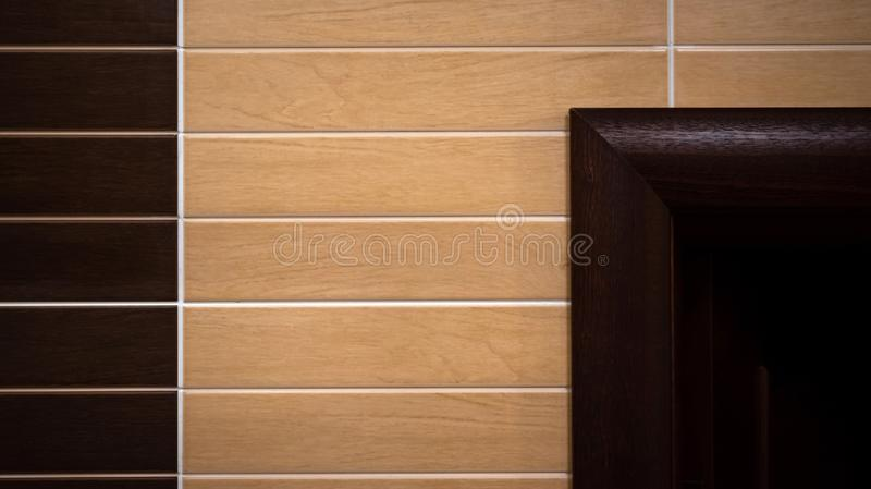 Bath tile wall. Surface background. Bath wall of brown light and dark colors tile wall. Surface background, abstract, architecture, backdrop, brick, block royalty free stock photo
