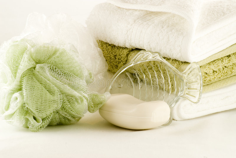 Bath Time 2. Bath items with soap, fish soap dish, sponge and towels royalty free stock images