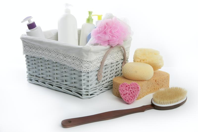 Bath toiletries basket with shower gel. Shampoo sponge and towel royalty free stock photography