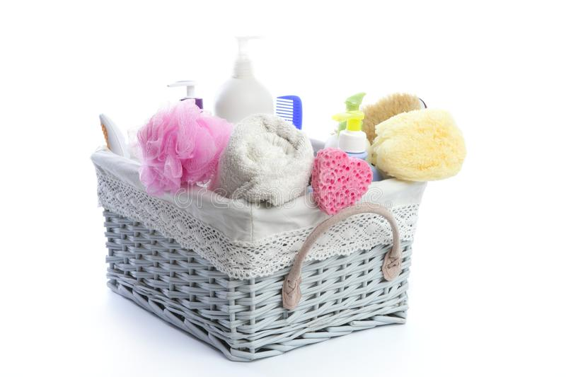 Bath toiletries basket with shower gel. Shampoo sponge and towel royalty free stock image