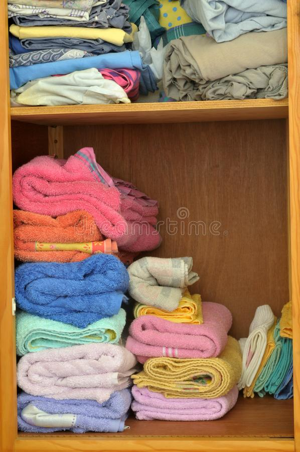Linen stored in a cupboard stock image