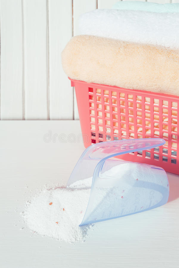 Bath towels and washing powder in measuring cup stock photography
