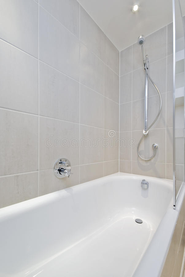 Bath Tub With Shower Attachment Stock Image - Image of house ...