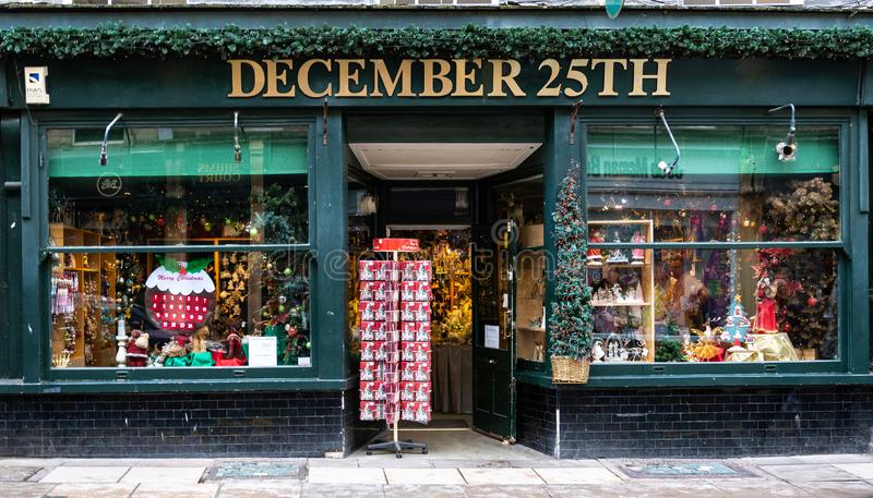 December 25th frontage. Bath, United Kingdom - October 13 2018: The front of December 25th Christmas decorations shop in Cheap St royalty free stock image