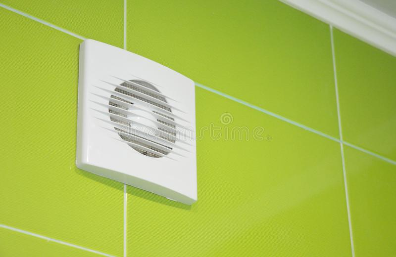 Bath vent fan with green tiles wall. White bathroom ventilation system. stock photo