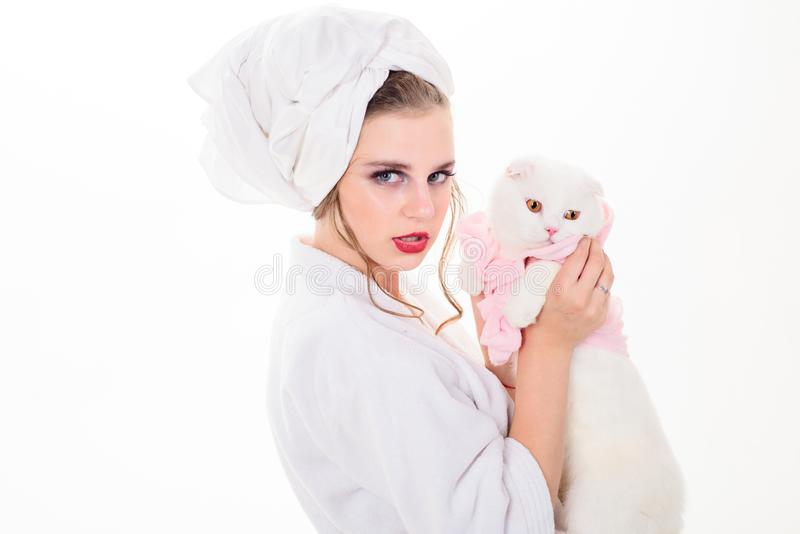 After bath. woman with fashion makeup hold white cat. Makeup cosmetics and skincare. Fashion jewelry and accessory royalty free stock photography