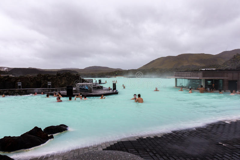 Bathers in blue lagoon, Iceland. Bathers in blue lagoon in Iceland on overcast day royalty free stock photography