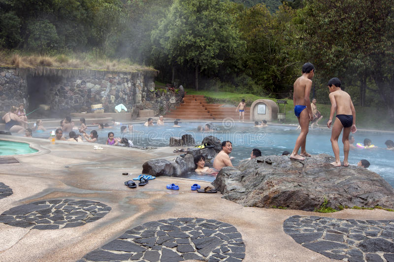 Bathers relax in a thermal pool at the Papallacta Hot Springs in Ecuador. Papallacta is Ecuador`s highest town at 3300 metres above sea level. The abundance of stock photo