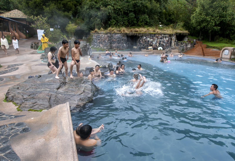 Bathers relax in a thermal pool at the Papallacta Hot Springs in Ecuador. Papallacta is Ecuador`s highest town at 3300 metres above sea level. The abundance of royalty free stock image