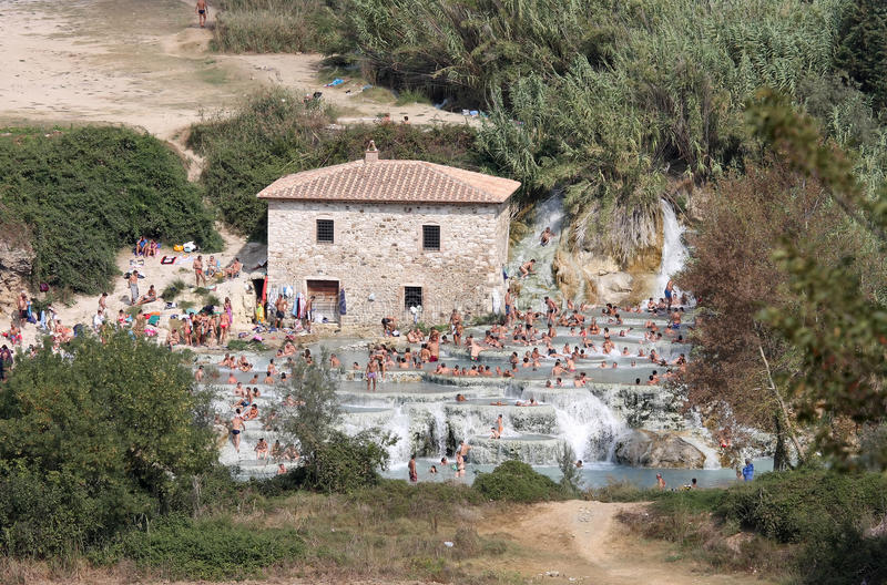 Bathers in the springs of Terme di Saturnia, Italy royalty free stock images
