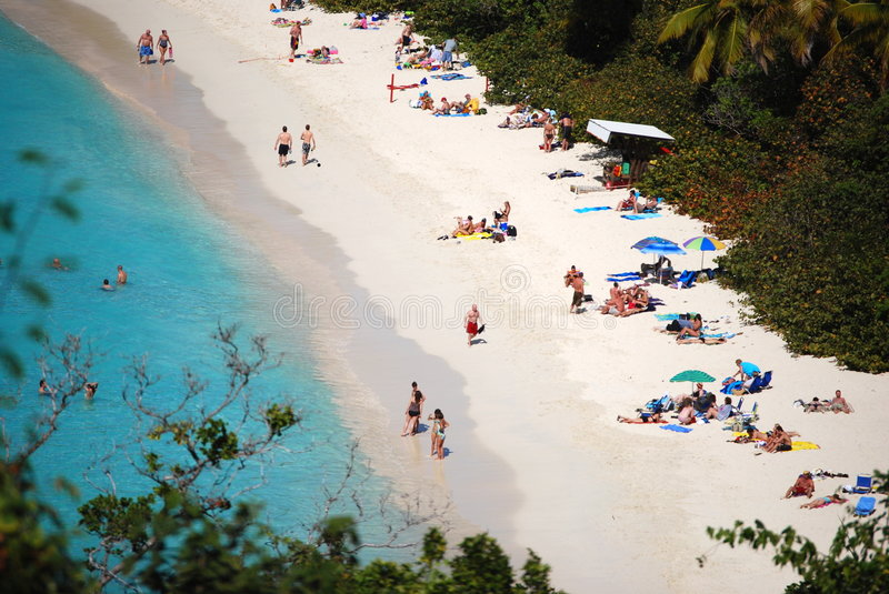 Bathers in Trunk Bay, USVI. Bathers enjoy warm Caribbean waters stock images