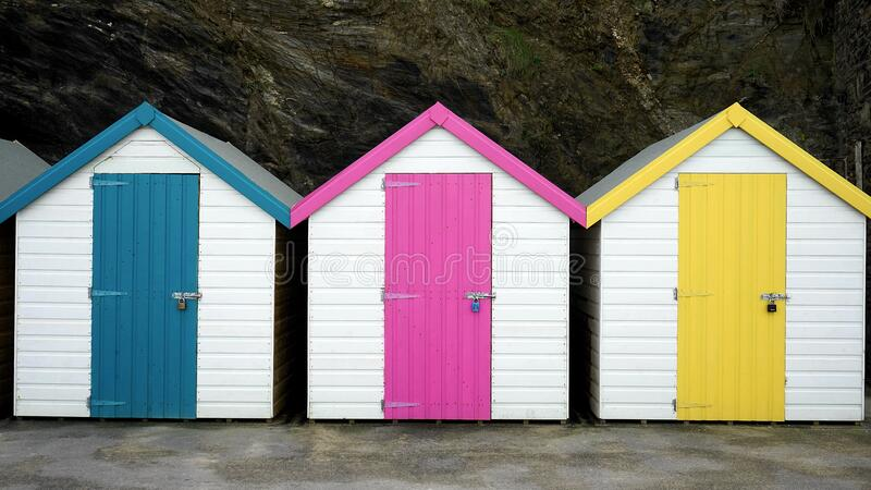 Bathing huts at bottom of cliff stock images